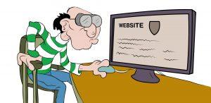 ein älterer Mann mit dicker Brille sitzt vor einem Computer. Auf dem Bildschirm steht Website.
